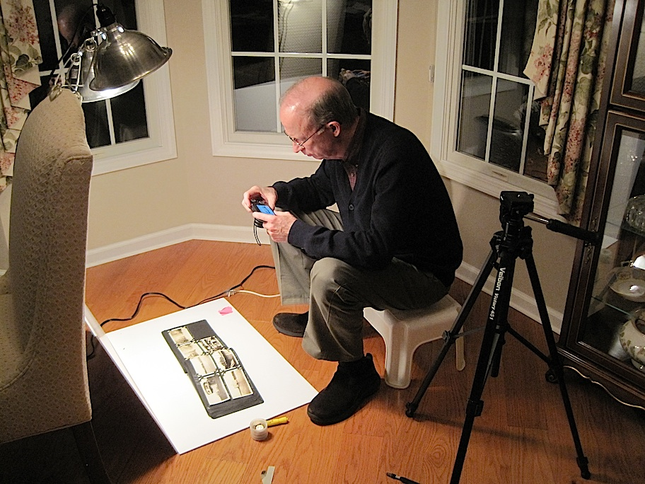 Chuck photograghing the albums.